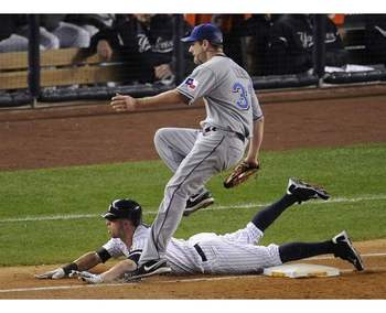 Photo Source: http://www.allvoices.com/contributed-news/7618903/image/65392671-texas-rangers-starting-pitcher-cliff-lee-puts-out-new-york-yankees-brett-gardner-sliding