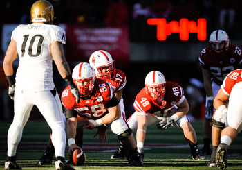 LINCOLN, NE - NOVEMBER 26: Cody Green #17 of the Nebraska Cornhuskers prepares to take a snap from teammate Mike Caputo #58  during their game at Memorial Stadium on November 26, 2010 in Lincoln, Nebraska. Nebraska defeated Colorado 45-17 (Photo by Eric F