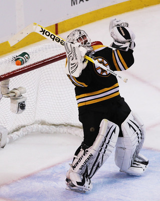 BOSTON, MA - MAY 27:  Tim Thomas #30 of the Boston Bruins celebrates their 1 to 0 win over the Tampa Bay Lightning in Game Seven of the Eastern Conference Finals during the 2011 NHL Stanley Cup Playoffs at TD Garden on May 27, 2011 in Boston, Massachusett