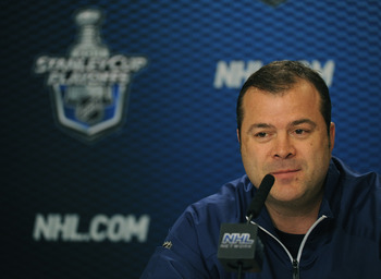VANCOUVER, BC - MAY 16:  Head Coach Alain Vigneault of the Vancouver Canucks speaks to the media at a press conference during the Stanley Cup Western Conference Finals practice at the Rogers Arena on May 16, 2011 in Vancouver, Canada.  (Photo by Harry How