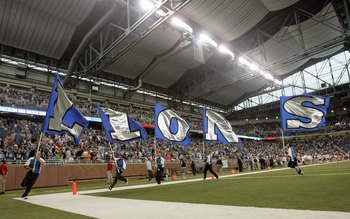 DETROIT - SEPTEMBER 30: Cheer squad carries flags on the field before the game between the Detroit Lions and the Chicago Bears on September 30, 2007 at Ford Field in Detroit, Michigan. The Lions defeated the Bears 37-27. (Photo by Jonathan Daniel/Getty Im