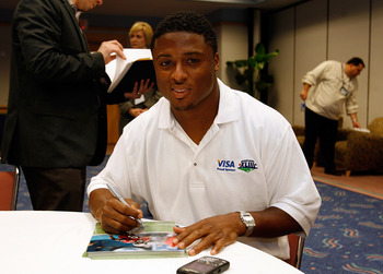 TAMPA, FL - JANUARY 26:  Running back Warrick Dunn of the Tampa Bay Buccaneers participates at the VISA 'Financial Football' Super Bowl at the Tampa Convention Center on January 26, 2009 in Tampa, Florida.  (Photo by J. Meric/Getty Images for VISA)
