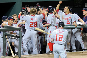 BALTIMORE, MD - MAY 20:  Jayson Werth #28 of the Washington Nationals is congratulated by teammates after hitting a home run in the fifth inning against the Baltimore Orioles at Oriole Park at Camden Yards on May 20, 2011 in Baltimore, Maryland. Washingto