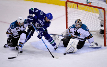 VANCOUVER, CANADA - MAY 24:  Goaltender Antti Niemi #31 of the San Jose Sharks makes a save on a scoring attempt by Alex Burrows #14 of the Vancouver Canucks as teammate Dan Boyle #22 tries to defend the play in the second period in Game Five of the Weste