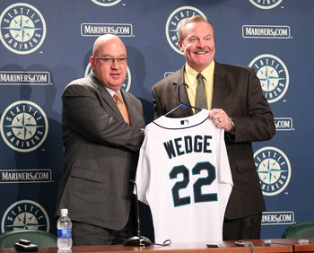 SEATTLE - OCTOBER 19:  New manager Eric Wedge (R) of the Seattle Mariners is introduced to the media by Executive Vice President & GM Jack Zduriencik at Safeco Field on October 19, 2010 in Seattle, Washington. (Photo by Otto Greule Jr/Getty Images)