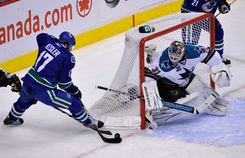 VANCOUVER, CANADA - MAY 24:  Ryan Kesler #17 of the Vancouver Canucks skates in for the short-side stuff-in attempt past Antti Niemi #31 of the San Jose Sharks in the first period in Game Five of the Western Conference Finals during the 2011 Stanley Cup P