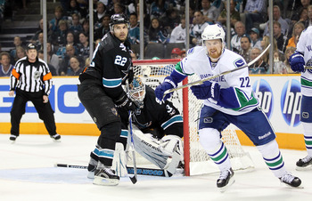 SAN JOSE, CA - MAY 22:  Goaltender Antti Niemi #31 and Dan Boyle #22 of the San Jose Sharks defend their net in Game Four of the Western Conference Finals as Daniel Sedin #22 of the Vancouver Canucks skates away during the 2011 Stanley Cup Playoffs at HP