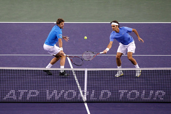 INDIAN WELLS, CA - MARCH 19:  Stanilas Wawrinka and Roger Federer of Switzerland play Xavier Malisse of Belgium and Alexandr Dolgopolov of the Ukraine during the doubles final of the BNP Paribas Open at the Indian Wells Tennis Garden on March 19, 2011 in