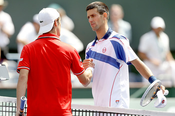 INDIAN WELLS, CA - MARCH 18:  Richard Gasquet of France congratulates Novak Djokovic of Serbia after their match during the BNP Paribas Open at the Indian Wells Tennis Garden on March 18, 2011 in Indian Wells, California.  (Photo by Matthew Stockman/Getty