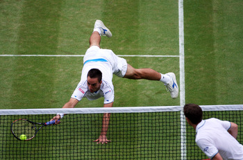 WIMBLEDON, ENGLAND - JUNE 27:  Viktor Troicki of Serbia dives to play a forehand during the men's singles third round match against Andy Murray of Great Britain on Day Six of the Wimbledon Lawn Tennis Championships at the All England Lawn Tennis and Croqu
