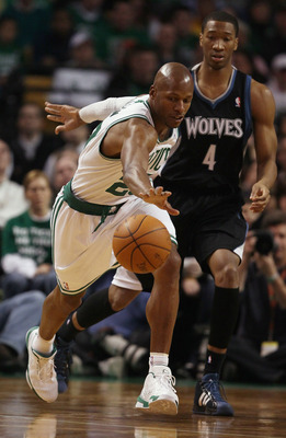 BOSTON, MA - JANUARY 03:  Ray Allen #20 of the Boston Celtics goes after a loose ball as Wesley Johnson #4 of the Minnesota Timberwolves defends on January 3, 2011 at the TD Garden in Boston, Massachusetts. NOTE TO USER: User expressly acknowledges and ag