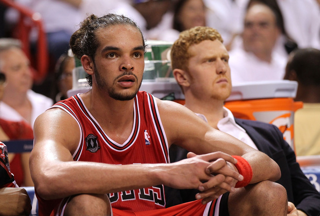 MIAMI, FL - MAY 22:  Joakim Noah #13 (L) and Brian Scalabrine #24 of the Chicago Bulls look on dejected from the bench late in the fourth quarter against the Miami Heat in Game Three of the Eastern Conference Finals during the 2011 NBA Playoffs on May 22,