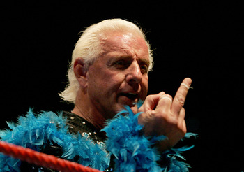 PERTH, AUSTRALIA - NOVEMBER 24:  Ric Flair gestures to the audience during his Hulkamania Tour at the Burswood Dome on November 24, 2009 in Perth, Australia.  (Photo by Paul Kane/Getty Images)