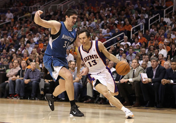 PHOENIX - DECEMBER 15:  Steve Nash #13 of the Phoenix Suns drives the ball past Darko Milicic #31 of the Minnesota Timberwolves during the NBA game at US Airways Center on December 15, 2010 in Phoenix, Arizona. The Suns defeated the Timberwolves 128-122.