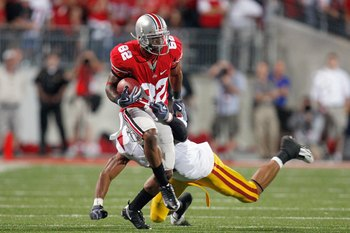 COLUMBUS, OH - SEPTEMBER 12: Ray Small #82 of the Ohio State Buckeyes carries the ball during the game against the Southern California Trojans on September 12, 2009 at Ohio Stadium in Columbus, Ohio. The Trojans defeated the Buckeyes 18-15. (Photo by Greg