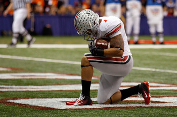 NEW ORLEANS, LA - JANUARY 04:  Dan Herron #1 of the Ohio State Buckeyes reacts after he scores on a nine-yard touchdown run in the first half against the Arkansas Razorbacks during the Allstate Sugar Bowl at the Louisiana Superdome on January 4, 2011 in N