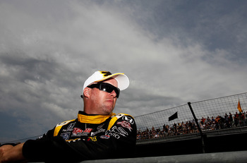 INDIANAPOLI, IN - MAY 22: Paul Tracy, driver of the #23 Wix Filters Dreyer & Reinbold Racing Dallara Honda, waits to drive  during qualifying for the the 95th Indianapolis 500 Mile Race at the Indianapolis Motor Speedway on May 22, 2011 in Indianapolis, I