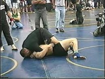 Nelson mounting Mir on his way to victory at Grappler's Quest in 2003.