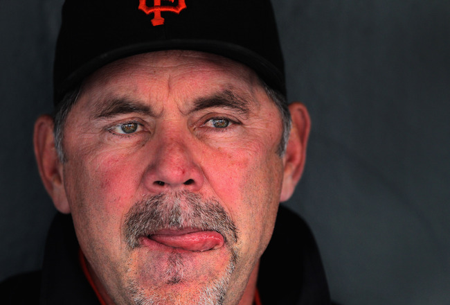 DENVER, CO - APRIL 19:  Manager Bruce Bochy of the San Francisco Giants looks on from the dugout as he chats with the media prior to facing the Colorado Rockies at Coors Field on April 19, 2011 in Denver, Colorado.  (Photo by Doug Pensinger/Getty Images)