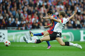 Vidic puts in at tackle against Barcelona's Pedro