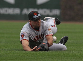 Schierholtz is your best defensive outfielder; he needs to play every day
