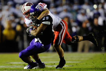 TCU FB Ed Wesley runs against Wisconsin in the 2011 Rose Bowl.