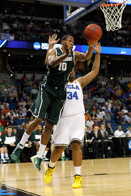 TAMPA, FL - MARCH 17:  Delvon Roe #10 of the Michigan State Spartans passes the ball in the second half against the UCLA Bruins during the second round of the 2011 NCAA men's basketball tournament at St. Pete Times Forum on March 17, 2011 in Tampa, Florid