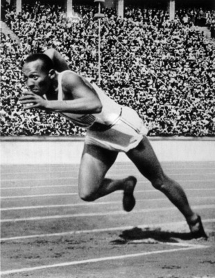 BERLIN - 1936 :  Jesse Owens of the USA in action in the mens 200m at the 1936 Summer Olympic Games held in Berlin, Germany.  Owens won a total of four gold medals in the Olympics, winning the mens 100m final, 200m final and the long jump competiton as we