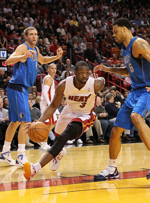 MIAMI, FL - DECEMBER 20:  Dwyane Wade #3 of the Miami Heat drives past Tyson Chandler #6 of the Dallas Mavericks during a game at American Airlines Arena on December 20, 2010 in Miami, Florida. NOTE TO USER: User expressly acknowledges and agrees that, by