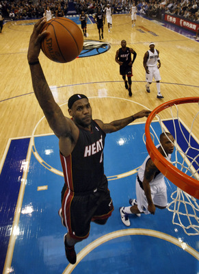 DALLAS - NOVEMBER 27: LeBron James #6 of the Miami Heat dunks on Caron Butler #4 of the Dallas Mavericks on November 27, 2010 at the American Airlines Center in Dallas, Texas. NOTE TO USER: User expressly acknowledges and agrees that, by downloading and o