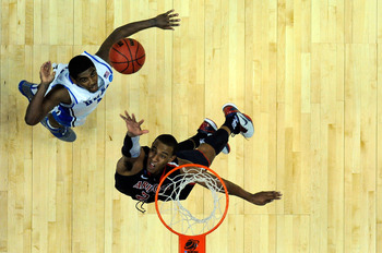 ANAHEIM, CA - MARCH 24:  Derrick Williams #23 of the Arizona Wildcats goes up for the ball against Kyrie Irving #1 of the Duke Blue Devils during the west regional semifinal of the 2011 NCAA men's basketball tournament at the Honda Center on March 24, 201