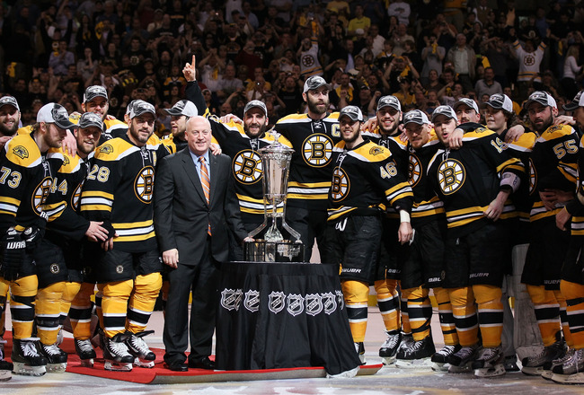 BOSTON, MA - MAY 27:  The Prince of Wales trophy is presented to the Boston Bruins by Deputy Commissioner Bill Daly after they defeated the Tampa Bay Lightning 1 to 0 in Game Seven of the Eastern Conference Finals during the 2011 NHL Stanley Cup Playoffs