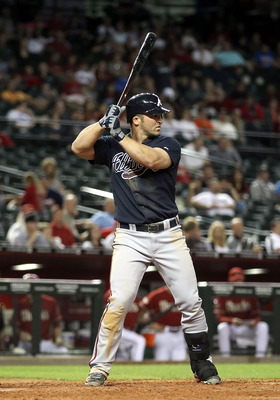 PHOENIX, AZ - MAY 18:  Dan Uggla #26 of the Atlanta Braves bats against the Arizona Diamondbacks during the Major League Baseball game at Chase Field on May 18, 2011 in Phoenix, Arizona.  The Diamondbacks defeated the Braves 5-4 in eleven innings.  (Photo