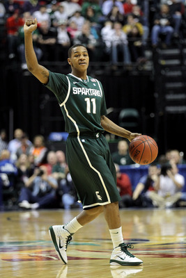 INDIANAPOLIS, IN - MARCH 12:  Keith Appling #11 of the Michigan State Spartans calls a play against the Penn State Nittany Lions during the semifinals of the 2011 Big Ten Men's Basketball Tournament at Conseco Fieldhouse on March 12, 2011 in Indianapolis,