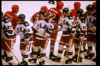 22 Feb 1980: General view of teams from the United States and the Soviet Union shaking hands after the semifinal hockey game during the Winter Olympics in Lake Placid, New York. The United States won the game 4-3. The game was dubbed The Miracle On Ice.