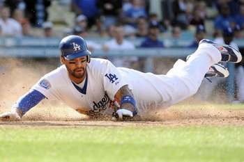 LOS ANGELES, CA - MAY 22:  Matt Kemp #27 of the Los Angeles Dodgers dives home to score a run against the Detroit Tigers during the game at Dodger Stadium on May 22, 2010 in Los Angeles, California.  (Photo by Harry How/Getty Images)
