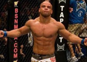 Thiago Alves celebrating a victory inside the Octagon