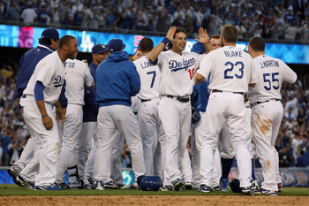 LOS ANGELES, CA - OCTOBER 08:  The Los Angeles Dodgers celebrate after Mark Loretta #5 hit a walk-off RBI to defeat the St. Louis Cardinals in Game Two of the NLDS during the 2009 MLB Playoffs at Dodger Stadium on October 8, 2009 in Los Angeles, Californi
