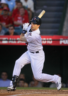 ANAHEIM, CA - JULY 13:  American League All-Star Joe Mauer #7 of the Minnesota Twins swings the bat during the 81st MLB All-Star Game at Angel Stadium of Anaheim on July 13, 2010 in Anaheim, California.  (Photo by Jeff Gross/Getty Images)