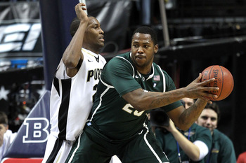 INDIANAPOLIS, IN - MARCH 11:  Derrick Nix #25 of the Michigan State Spartans looks to pass against JaJuan Johnson #25 of the Purdue Boilermakers during the quarterfinals of the 2011 Big Ten Men's Basketball Tournament at Conseco Fieldhouse on March 11, 20