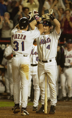 21 Sep 2001:   Robin Ventura #4 of the New York Mets congratulates Mike Piazza #31 after Piazza hit a 2-run home run in the eighth inning of the Mets game against the Atlanta Braves at Shea Stadium in Flushing, New York .  The Mets won 3-2. <DIGITAL IMAGE