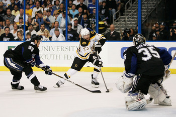 TAMPA, FL - MAY 21:  Michael Ryder #73 of the Boston Bruins shoots a first period goal against the defense of Mike Lundin #39 and Dwayne Roloson #35 of the Tampa Bay Lightning in Game Four of the Eastern Conference Finals during the 2011 NHL Stanley Cup P