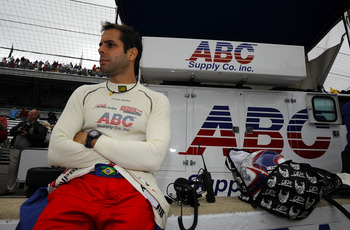 INDIANAPOLIS, IN - MAY 27:  Vitor Meira of Brazil, driver of the #14 ABC Supply Co A.J. Foyt Racing Dallara Honda, looks on during final practice on Carb Day for the 95th running of the Indianapolis 500 on May 27, 2011 at Indianapolis Motor Speedway in In