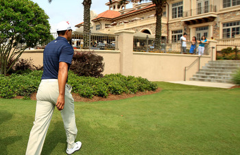 PONTE VEDRA BEACH, FL - MAY 12:  Tiger Woods leaves the course after withdrawing after playing the ninth hole during the first round of THE PLAYERS Championship held at THE PLAYERS Stadium course at TPC Sawgrass on May 12, 2011 in Ponte Vedra Beach, Flori