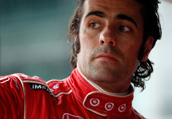 INDIANAPOLIS, IN - MAY 27:  Dario Franchitti, driver of the #10 Target Chip Ganassi Racig Dallara Honda, looks on during final practice on Carb Day for the the 95th Indianapolis 500 Mile Race at the Indianapolis Motor Speedway on May 27, 2011 in Indianapo