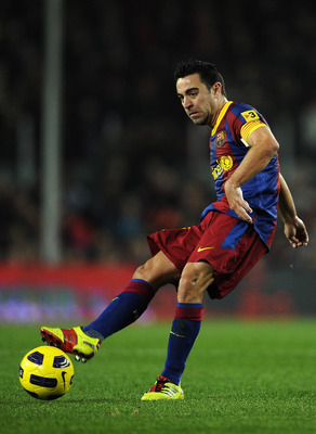 BARCELONA, SPAIN - JANUARY 02:  Xavi Hernandez of Barcelona passes the ball during the La Liga match between Barcelona and Levante UD at Camp Nou on January 2, 2011 in Barcelona, Spain. Barcelona won 2-1.  (Photo by David Ramos/Getty Images)