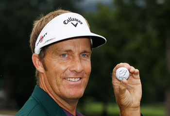 WHITE SULPHUR SPRINGS, WV - AUGUST 01:  Stuart Appleby of Australia poses with his golf ball after he finished with an 11-under par 59 during the final round of the Greenbrier Classic on The Old White Course at the Greenbrier Resort  on August 1, 2010 in