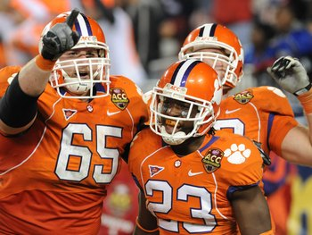 TAMPA, FL - NOVEMBER 28: Running back Andre Ellington #23 of the Clemson Tigers celebrates a touchdown run with guard Thomas Austin #65 against the Georgia Tech Yellow Jackets in the 2009 ACC Football Championship Game December 5, 2009 at Raymond James St