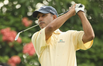KUALA LUMPUR, MALAYSIA - APRIL 14:  Jeev Milka Singh of India in action during the first round of the Maybank Malaysian Open at Kuala Lumpur Golf & Country Club on April 14, 2011 in Kuala Lumpur, Malaysia.  (Photo by Ian Walton/Getty Images)