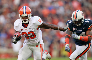 AUBURN, AL - SEPTEMBER 18:  Andre Ellington #23 of the Clemson Tigers breaks a tackle by Demond Washington #14 of the Auburn Tigers at Jordan-Hare Stadium on September 18, 2010 in Auburn, Alabama.  (Photo by Kevin C. Cox/Getty Images)